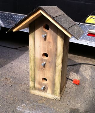 High rise or multi-story bird house that Mick Posner built with this son
