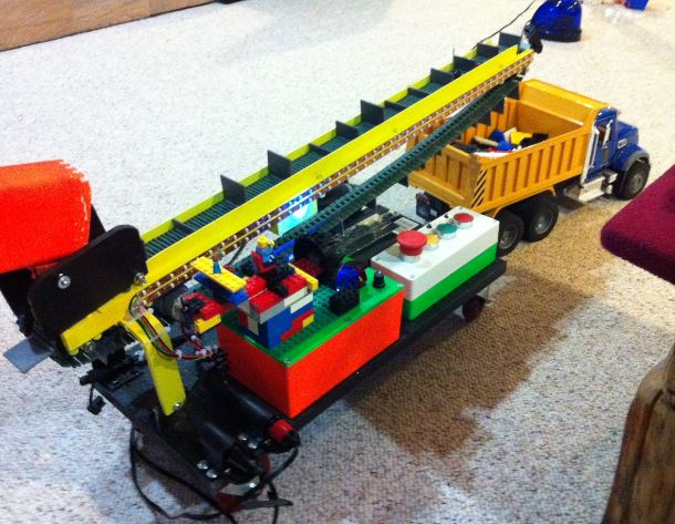 Mick built conveyor belt toy. Belt runs, conveyor goes uo and down