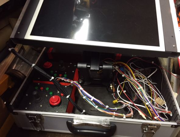 Mick Built Toys, prototype of monitor and controllers in a briefcase