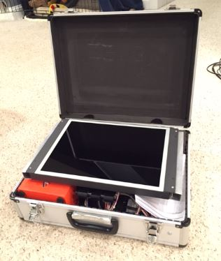 Looking inside Mick built toys gaming console in a briefcase