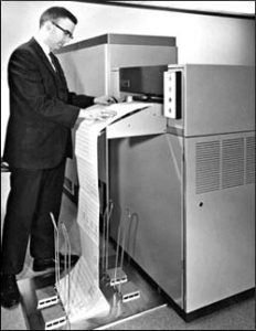ORA founder Thomas Harris reading a printout from ORA's computer with CODE V in 1975.
