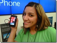 Neda holding up Windows 7 Phone at Microsoft Store